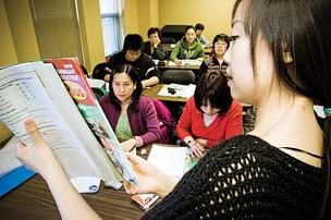 Instructor Wenjing Zhou leads her English language class at the Chinatown Neighborhood Center.