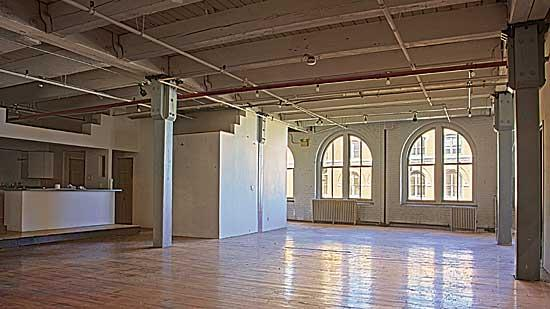 An empty apartment at 381 Congress St. Developers say it's important that retail and residential development complement each other.
