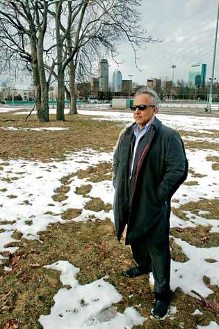 Kamran Zahedi, principal of Urbanica, on the lot near Dudley Square at the corner of Melnea Cass Boulevard and Washington Street where it plans to build a hotel and apartment building.