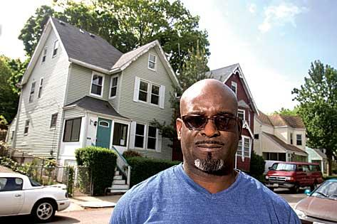 Ricardo Henry, outside the Dorchester house he claims was wrongly foreclosed upon.
