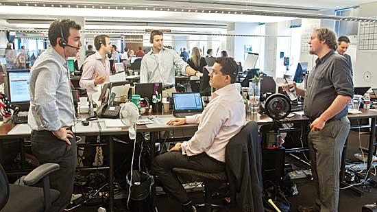 """Rapid7 employees in the """"bullpen"""" at its corporate headquarters on the 29th floor of The Prudential Center."""