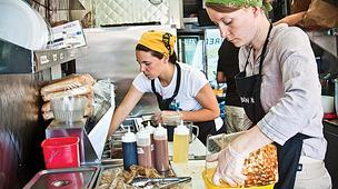Pushcart War. Phantom Gourmet host Dave Andelman writes that food trucks are stealing bread out of the mouths of restaurant owners. His argument doesn't hold water. (Pictured: Workers at the Bon Me food truck, parked downtown.)
