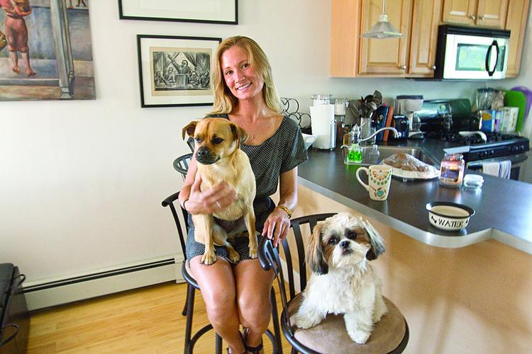 Andrea McDonough, who rents an apartment in South Boston with her two dogs, says tenants with pets are having a hard time finding an apartment in the city's tight rental market.