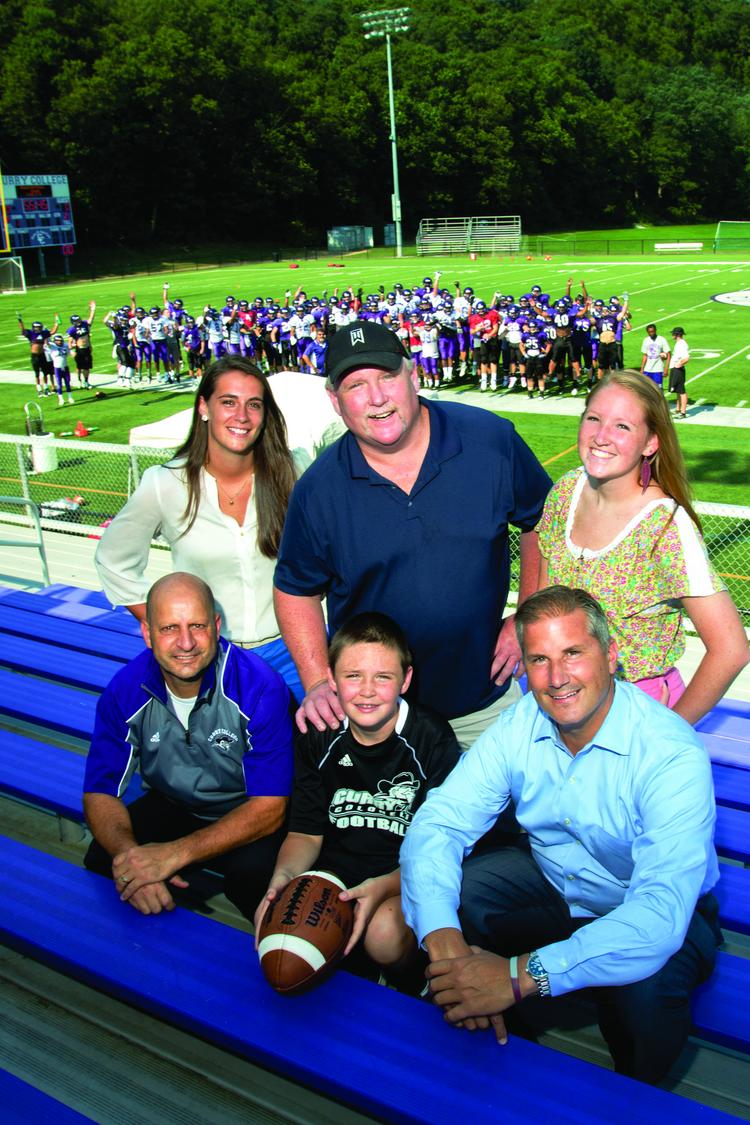 Making an impact: Seated: Vinnie Eruzione, Curry College athletic director; Shane Heffernan, honoree team member; and Jay Calnan of J. Calnan & Associates. Standing: Maura Mahoney, director of case management, Team Impact, Shane's father, Thomas Heffernan, and sister Kelsey.