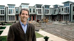 Charles Aggouras, president and CEO of GFC Development, in front of the Somerville units his firm is building.