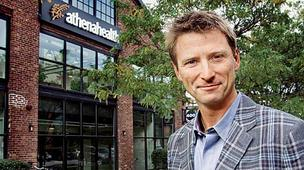 Athenahealth CEO Jonathan Bush aims to triple his company's Boston-area footprint, and is eyeing space in the planned New Balance complex in Brighton.