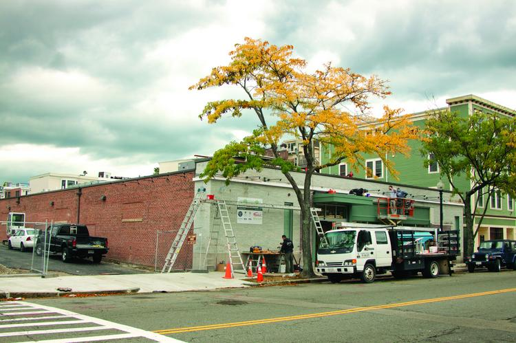 Work is in progress at the soon-to-open Foodie's market on West Broadway in South Boston. The market is being built at the former site of the American Nut & Chocolate Co. and will feature an 8,500-square-foot store with traditional and gourmet foods.
