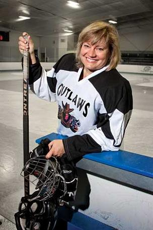 After work, Dr. Martha Smith-Blackmore stays cool by playing left wing for the The Outlaws hockey squad.