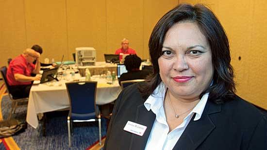 Jessica Garcia, vice president of national mortgage outreach for Bank of America, travels the country to oversee loan modification fairs aimed at helping prevent foreclosures and keeping people in their homes.