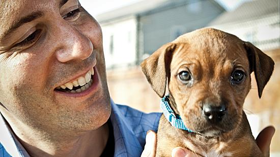 Rob Halpin, director of public relations at MSPCA-Angell, with 8-week-old Schroeder. The animal-rescue organization has more than 20,000 likes on Facebook.