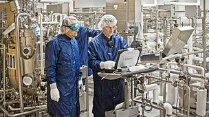 Genzyme workers at the Framingham facility preparing to produce the Fabry drug Fabrazyme.