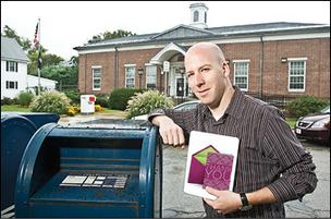Matt Douglas, CEO of punchbowl.com, outside the Natick post office. His company is one of many whose technology will likely add to the U.S. Postal Service's woes.