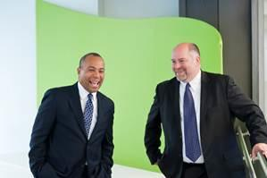 Eric White, the new director of Boston Society of Architects, shares a laugh with Gov. Deval Patrick.