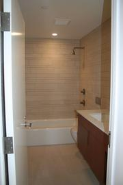 The full bathroom in the 930-sqaure-foot apartment for lease at the Hayden building across from the Kensington on lower Washington Street in Boston.