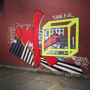 A graffiti-inspired mural was designed by a Boston artist to promote Ink Block, the $200 million mixed-use development of the Boston Herald.