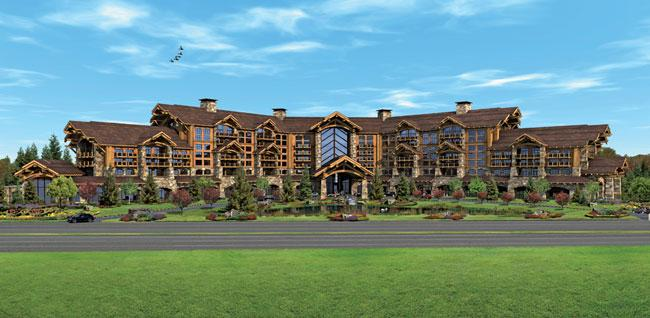 Wynn Resorts will drop plans to build a casino on land owned by the Kraft Group near Gillette Stadium and its Patriot Place shopping mall. Pictured: An artist's rendering released by the developers in March.