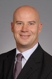 CB Richard Ellis/N.E. Partners added two to its debt and equity team, including Kyle Juszczyszyn.
