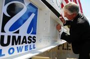 Chancellor Marty Meehan signed a steel beam that was the last one placed in the frame of the university's new $95 million student center at University Crossing.