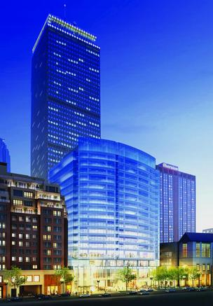 Construction of the approved 17-story building at 888 Boylston St. is on hold until the market turns.