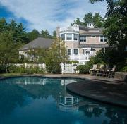 """Underwater? The """"heated pool with waterfall"""" at Curt and Shonda Schilling's Massachusetts mansion."""