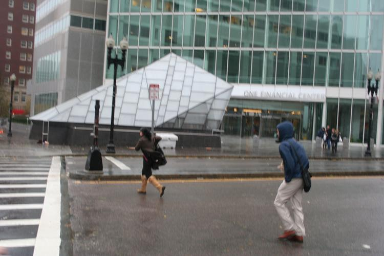 Commuters heading to South Station near One Financial Center.