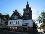 The Queen Anne style Methodist Episcopal Church in Ware was built in 1897. It features curved pews, fireplaces and stained glass windows. The church operated until 1978 when the town took it over for offices and a senior center. It has been vacant since 2008 when a new senior center was built, and the town has been unable to sell the building.