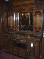 This wood hutch with a wall mirror is among the furniture items at the Locke-Ober auction.