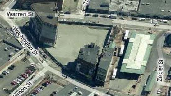 Two Dudley Square properties the City of Boston plans to seize appear at bottom center in this aerial photo, adjacent to the bus station: 2326 Washington St. is on the right; 2304 Washington St. is on the left. The larger Ferdinand Building is depicted, top left.