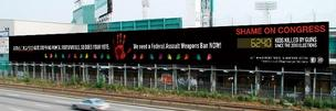 John Rosenthal has added 20 small hands to his 252-foot billboard on the Massachusetts Turnpike representing the 20 children killed at the Sandy Hook Elementary.