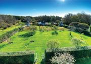 Another view of the large, landscaped gardens on the 26-acre compound in Osterville, formerly owned by Bunny Mellon.