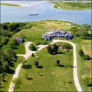 The 260 Polpis Road property on Nantucket features 20 rooms and 9.5 baths along with guest cottages, a tennis court, boathouse and spectacular panoramic views of Nantucket's Polpis Harbor.