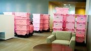 Allen & Gerritsen used pink breast-cancer-awareness crates for their move from Watertown to Boston's Innovation District.