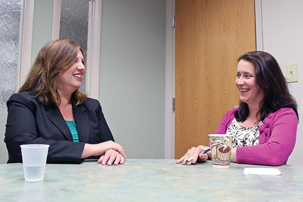 Julie Loesch, left, of the Center for Family Justice talks dispute resolution with mediation manager Bridget O'Connell.