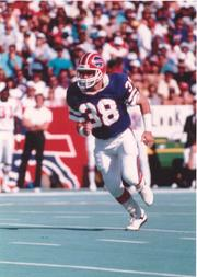 Mark Kelso played safety for the Buffalo Bills' Super Bowl teams and today is one of the team's radio announcers.