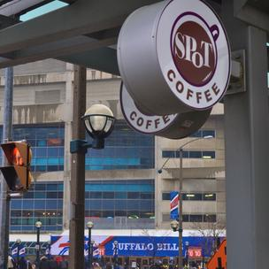 Signs of Buffalo in Toronto: Spot Coffee in the foreground; Buffalo Bills banners on the Rogers Centre in the background.