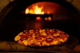 """Fire it up! Pizza Amore """"The Wood Fire Way"""" is a Buffalo food truck with a mobile brick oven that tops 750 degrees."""