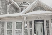 This home on Orchard Park road in West Seneca was lashed by the blizzard.