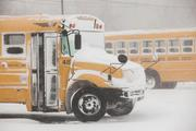 Buses sit idle at the West Seneca Central School District's bus garage. Schools throughout the region were closed today.