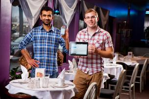 Ansar Kahn and James O'Leary display their technology.