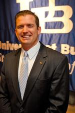 UB hires White as director of athletics