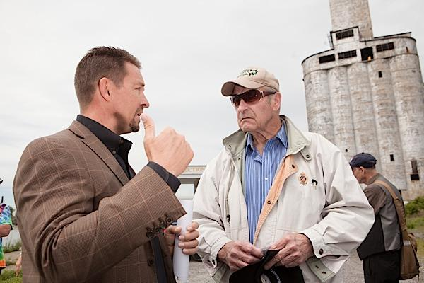Robert Bencini, left, talks with co-owner William Mackey following Wednesday's auction for the Cargill Pool Elevator on Fuhrmann Boulevard.