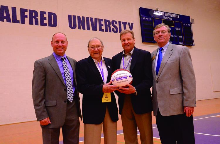 From left, Paul Vecchio, Alfred director of athletics; Terry Galanis Sr.; Terry Galanis Jr.; and Alfred University President Charley Edmondson.