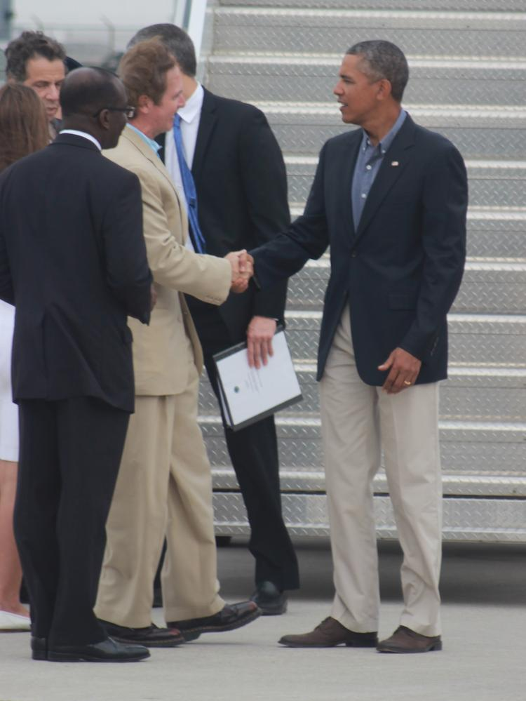 Rep. Brian Higgins among the delegation to greet President Barack Obama at Buffalo Niagara International Airport on Aug. 22.