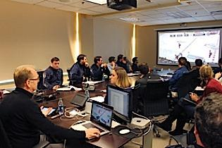 General Manager Darcy Regier is teaching fellow Sabres' employees during a work stoppage.