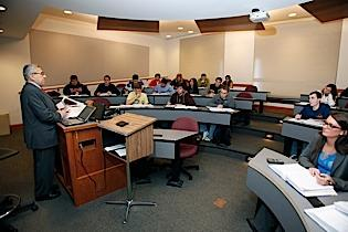 Enrollment in accounting programs at Canisius College and other institutions continues to rise, in part because of steady post-graduation job opportunities. Canisius professor Edward Gress, left, addresses an intermediate accounting class.