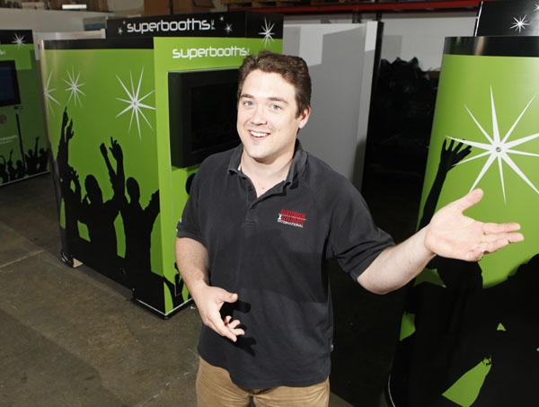 Gregory Bacorn and his staff are building eight-person photo booths outfitted with a computer, camera, wind machine and video screens.