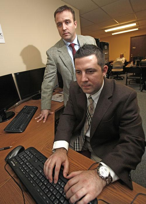 Mark Ferm, left, of Tronconi Segarra & Associates and Kyle Cavalieri of DIGITS LLC are on the trail of data thieves.