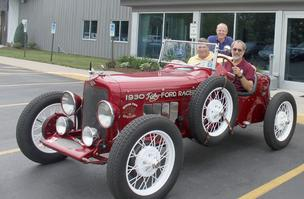 Rick McIntosh, left, president of MAC's Antique Auto Parts, Co., is navigator for the 10-day race. Keith Wallace, at the wheel and Brent Powley, will share driving duties with the fourth member of the  team, Doug Stolzenburg of Burt.
