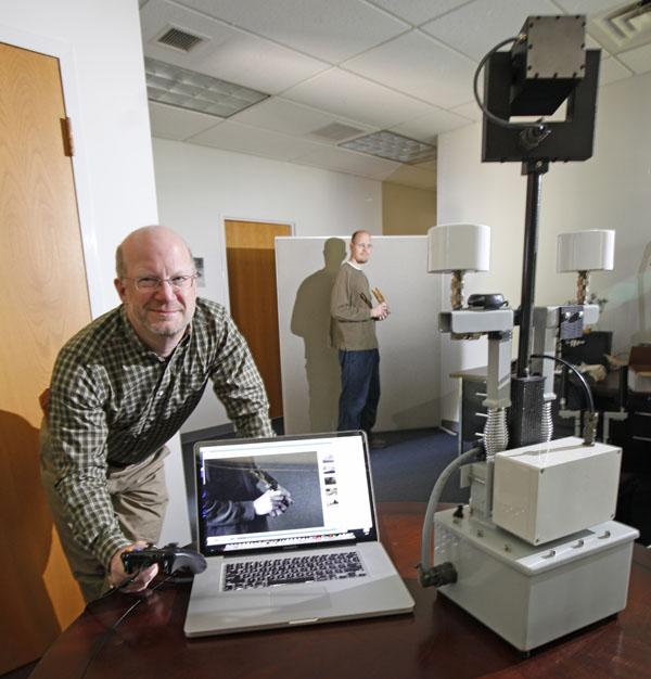 Allen Mann, left, and Joe Pulver of Lithos Robotics demonstrate their remote surveillance device with zoom lens.