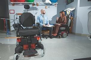 Brian Porebski, director of physical therapy at People Inc., said patients of the agency's Elmwood Health Center like Cynthia Blaszkowiak will find difficulty having wheelchairs and other items serviced under new bidding rules by the Centers for Medicare & Medicaid Services.